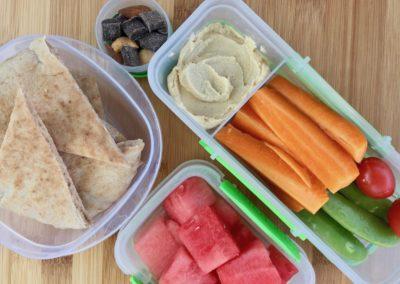 Whole wheat pita, hummus, veggies, watermelon, trail mix