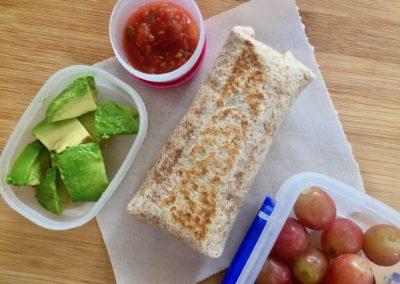 Bean & cheese burrito with salsa, avocado and grapes
