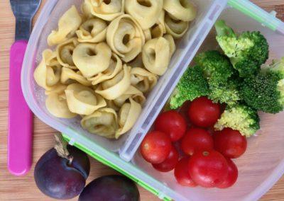 Mini pesto tortellini, broccoli, cherry tomatoes, plums
