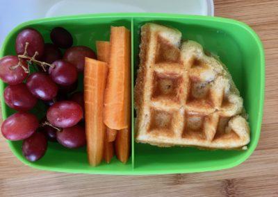 Maple almond butter waffle sandwich, grapes, carrot sticks