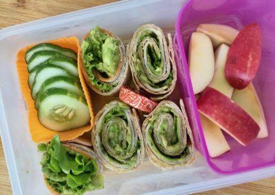 Turkey avocado roll-ups, apple slices, cucumber