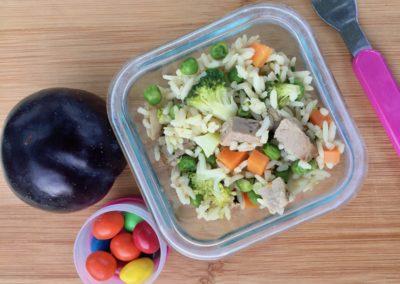 Garlic rice with pork and veggies, plum, peanut M&M's