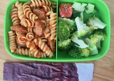 Rotini with marinara and chicken sausage, broccoli, plum fruit leather, chocolate