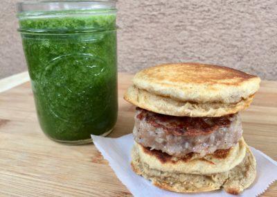 Pancake sausage sandwich, green smoothie