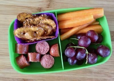 Hot dog bites, pretzels, carrot sticks, grapes
