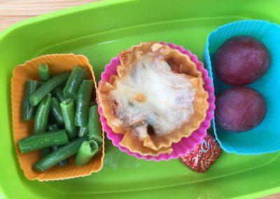 Lasagna cup, green beans, plums, chocolate