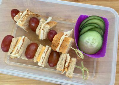 Turkey sandwich bites, grapes, cucumber